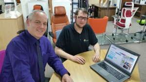 Craig Hughes (left) receives some training on how to update the new website by Joshua Gidman, Yarrington's senior digital designer.