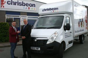 Luke Pitt (left) hands over the keys of the new Vauxhall Movano Luton conversion to Craig Hughes.