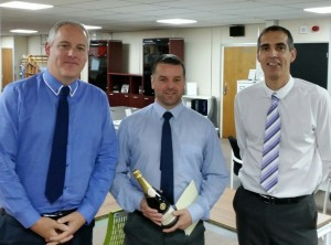 Helping Jim (centre) to celebrate his 25 years with Chrisbeon are partners Craig Hughes (left) and Richard Hughes (right).