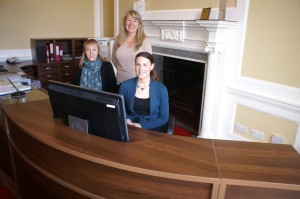 Left to right Emmeline, Wendy and Amanda behind the new office and reception counter at Concord College.